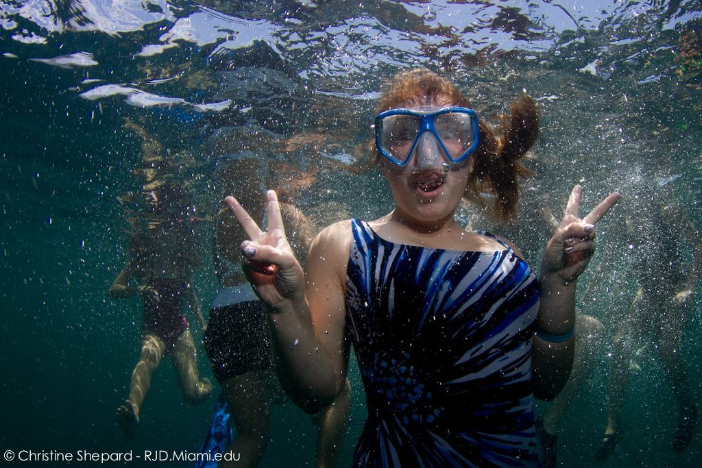 A South Broward High School Student bursts with excitement in her underwater portrait during a field trip with RJD.
