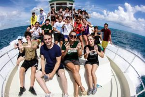 The participants pose for a picture after a successful day of shark tagging