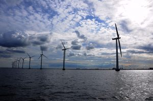 Windmill park in Oresund between Copenhagen, Denmark and Malmo, Sweden. (Photo source: Wikimedia Commons)