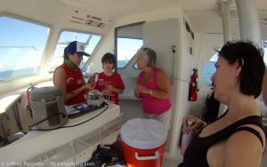Shark Intern Leila AtallahBenson showing volunteers our blood analysis protocol