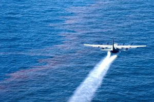 An airplane spraying dispersants over an oil slick in the Gulf of Mexico (Source: Wikimedia Commons)